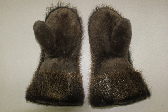 men's gloves made of natural fur for riding a snowmobile